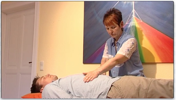 Reiki Master and healer Katrin Haun examining a patient using a quantum medicine method